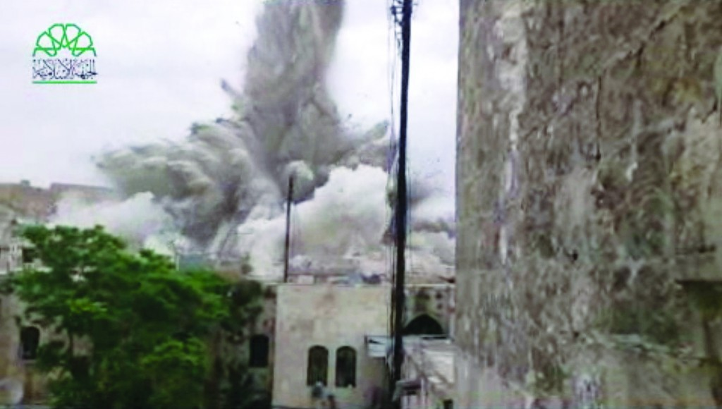 This image made from amateur video shows an explosion that destroyed the Carlton Hotel in Aleppo, Syria, Thursday. (AP Photo/Shaam News Network via AP video)