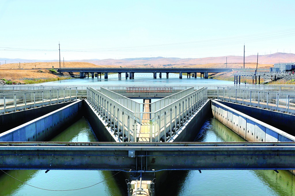 In this Sept. 23, 2013 file photo, water flows through fish diversion louvres at the John E. Skinner Delta Fish Protective Facility from the Clifton Court Forebay on its way to the Harvey O. Banks pumping plant, near Tracy, Calif. (AP Photo/Rich Pedroncelli, file)