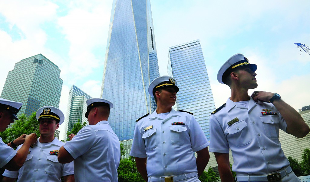 Naval officers on Friday participate in a joint re-enlistment and promotion ceremony at the National September 11 Memorial Museum site. (AP Photo/Bebeto Matthews)