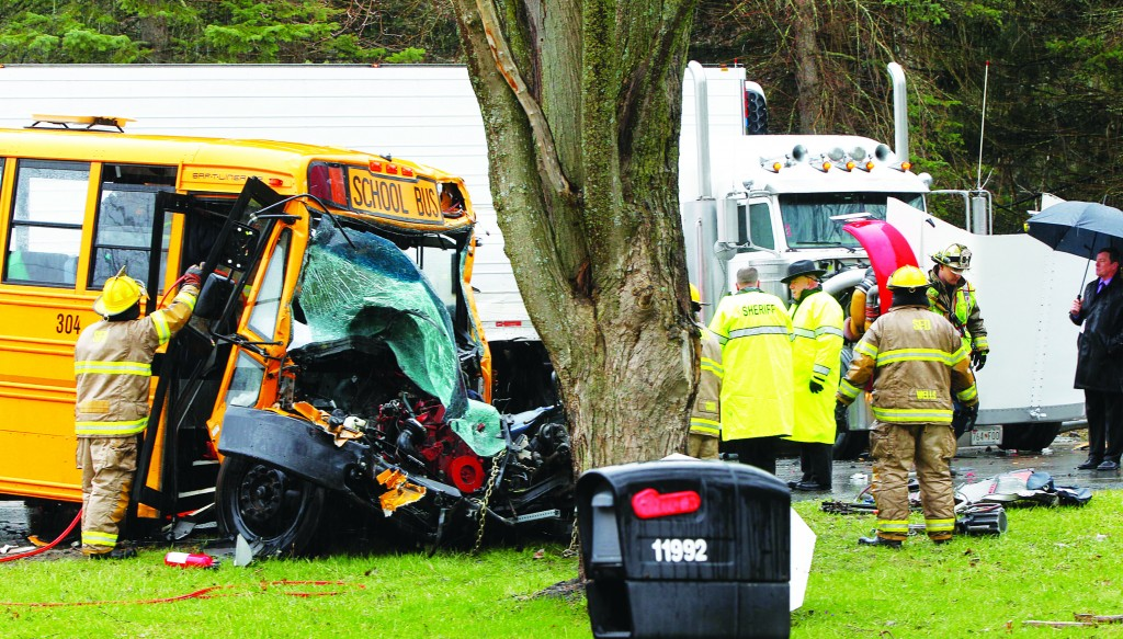 Fireman use the Jaws of Life to extricate bus driver Marlene Golabek after a semi collided with her bus Wednesday. (AP Photo/The Buffalo News, Harry Scull Jr.)