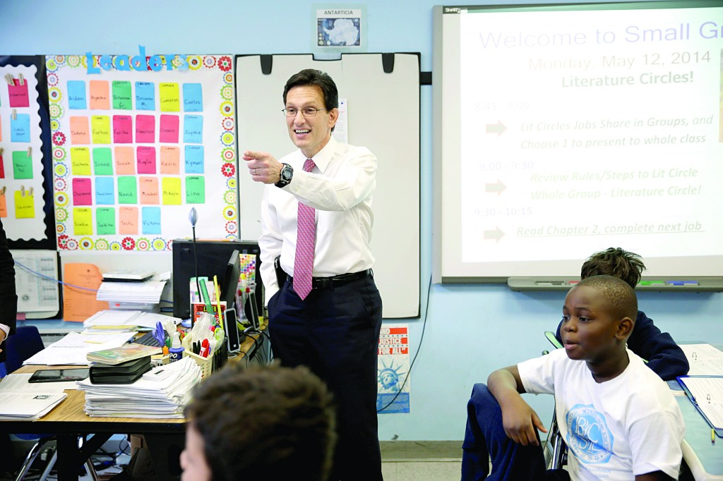 House Majority Leader Eric Cantor on Monday visits with students at a Bronx charter school. (AP Photo)