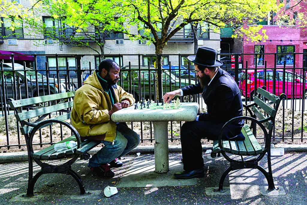 Rabbi Dovid Bergman last Wednesday playing chess with a man who stopped him and asked for a game, in Manhattan's Union Square. (Mo Gelber)