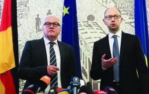 German Foreign Minister Frank-Walter Steinmeier, left, and Ukrainian Prime Minister Arseniy Yatsenyuk take part in a briefing in Kiev, Ukraine, Tuesday. (AP Photo/Sergei Chuzavkov)