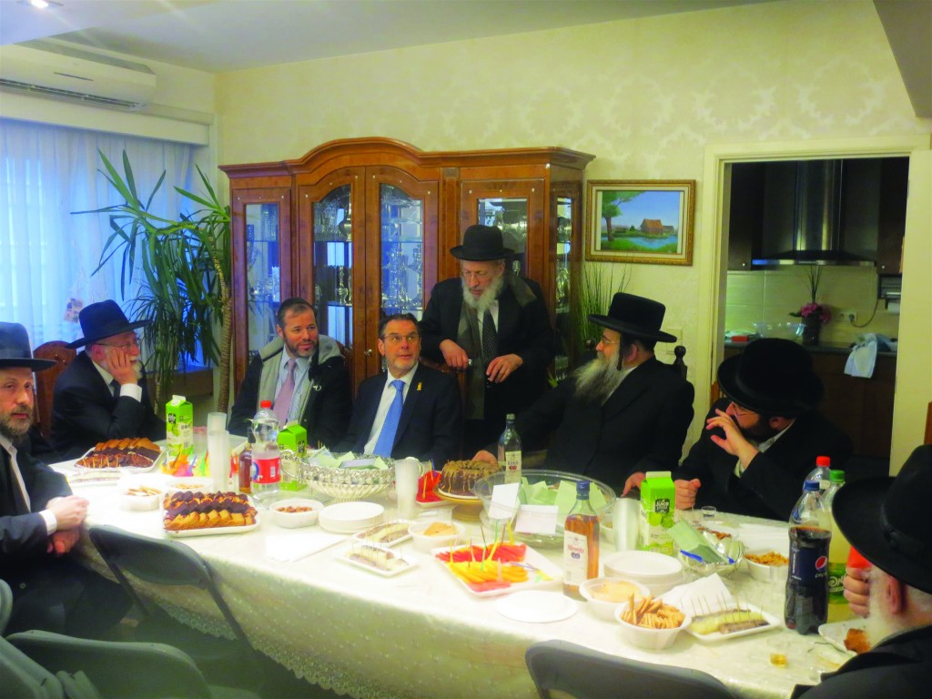 At the meeting held in the home of Harav Aharon Schiff, shlita (seated, 2nd right). Standing behind him is Reb Pinchas Kornfeld.  (Mordechai Zev Schwamenfeld)