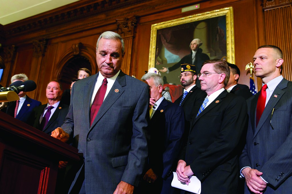 Surrounded by veterans and GOP House members, Rep. Jeff Miller (R-Fla.)  chairman of the House Committee on Veterans' Affairs, finishes a statment calling for reforms in the wake of gross mismanagement and misconduct at Veterans Administration hospitals, at the Capitol in Washington, Thursday. (AP Photo/J. Scott Applewhite)