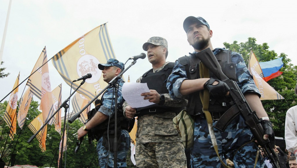 Self-styled governor of Luhansk region Valery Bolotov (C) delivers a speech during a rally to mark and celebrate the announcement of the results of the referendum on the status of Luhansk region in Luhansk Monday (REUTERS/Valentyn Ogirenko)