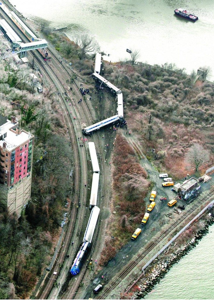 In this Dec. 1, 2013 file photo, a Metro-North passenger train lays on its side after derailing on a curved section of track in the Bronx borough of New York. (AP Photo/Mark Lennihan, File)