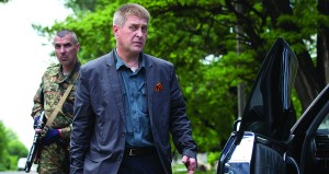 Vacheslav Ponomarev, the self-proclaimed mayor of Slovyansk, walks to his car after visiting a polling station in Slovyansk, Ukraine, on Sunday. (AP Photo/Alexander Zemlianichenko )