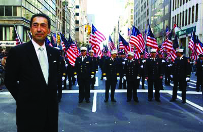 Former Chief of Department Daniel Nigro watches a Columbus Day parade with FDNY marchers in this 2002 photo. (New York City)