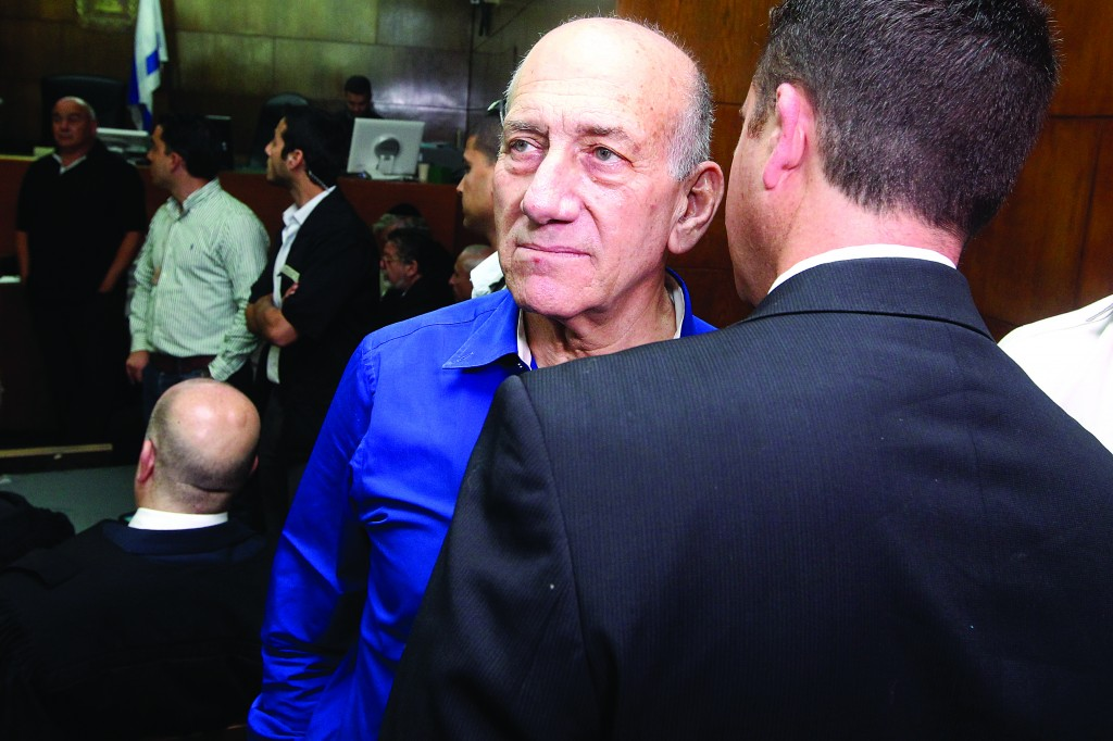 Former Israeli Prime Minister Ehud Olmert seen at the District Court in Tel Aviv where he was sentenced on charges of accepting bribes, on Tuesday. (Ami Shooman/POOL/Flash90)