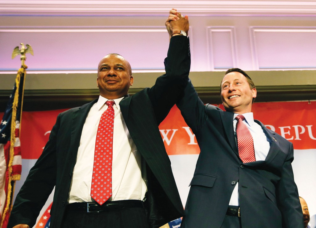 Republican nominees Rob Astorino (R) for governor and Christopher Moss for lieutenant governor, on Thursday stand on stage during the convention. (AP Photo/Seth Wenig)