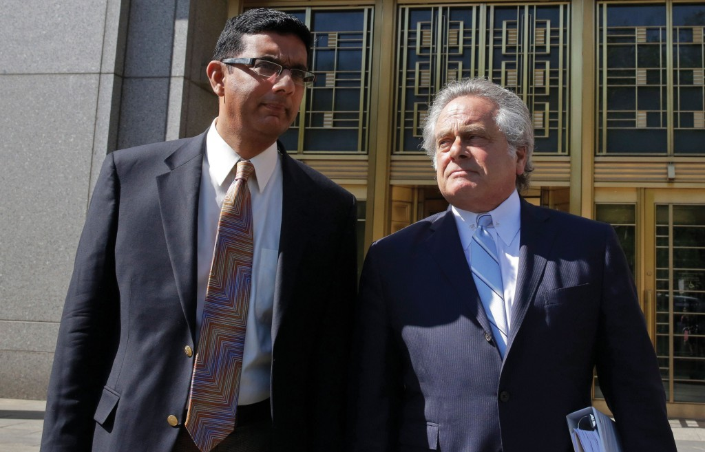 Dinesh D'Souza, left, accompanied by his lawyer Benjamin Brafman on Tuesday, leave federal court in New York. (AP Photo/Richard Drew)
