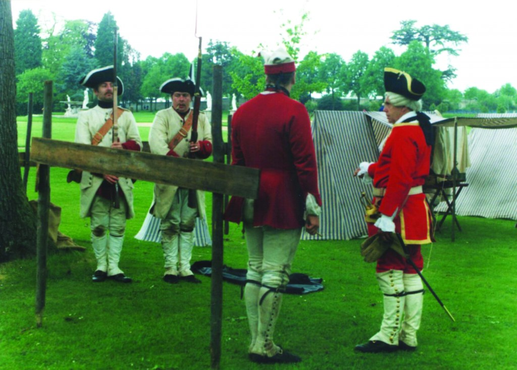 A 2009 reenaction of French soldiers surrendering to the British, right, at the Battle of Lake George in 1755. (Flintlock and Tomahawk)