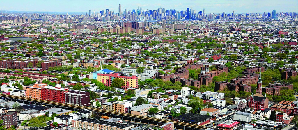 Anything affordable here? An aerial view of Brooklyn, with the Manhattan skyline in the distance. (AP Photo/Mark Lennihan )