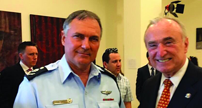 Commissioner William Bratton on Sunday meeting his Israeli counterpart, Yochanan Danino, in Tel Aviv.