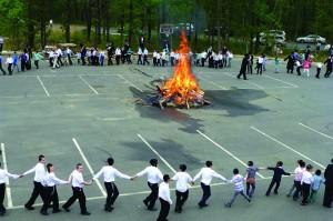 Talmidim of Lakewood's Yeshivah Toras Emes on Sunday dance at a bonfire.(TheLakewoodScoop.com)