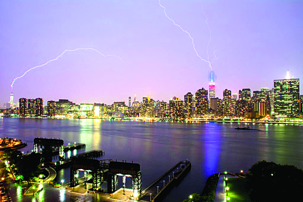 Lighting Up the Towers: Lightning on Friday night strikes simultaneously at the Empire State Building (right) and One World Trade Center in Manhattan. (Jon Rubino/Twitter)