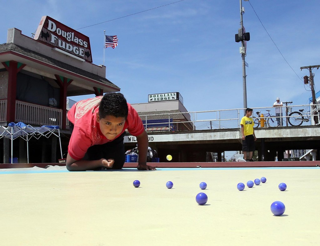 Erubey Sanchez, 11, prepares to shoot during an inter-school marbles tournament Monday in Wildwood, N.J. The overall winner will go on to compete in the National Marbles Championships in June. (AP Photo/The Press of Atlantic City, Dale Gerhard)