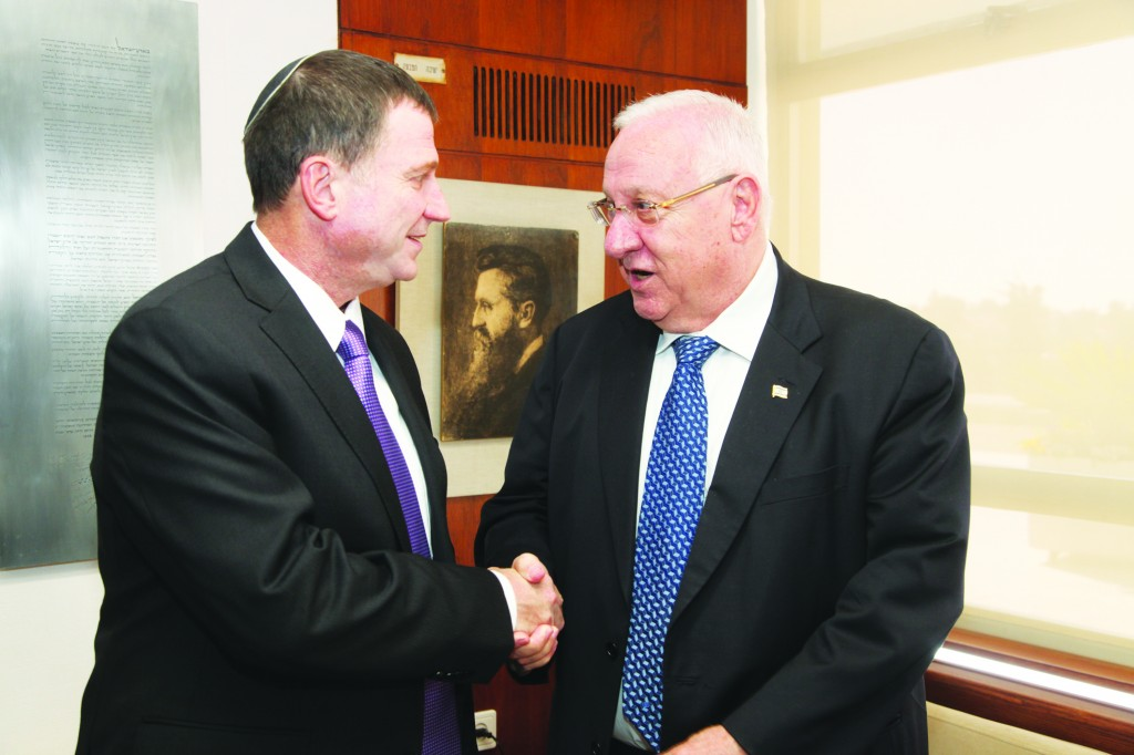 MK Reuven Rivlin, delivers to Speaker of the Knesset Yuli Edelstein (L) his candidacy for president. (Issac Harari/Knesset Spokesperson/Flash90)