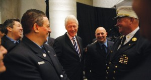 Former President Bill Clinton shares a laugh with first responders.