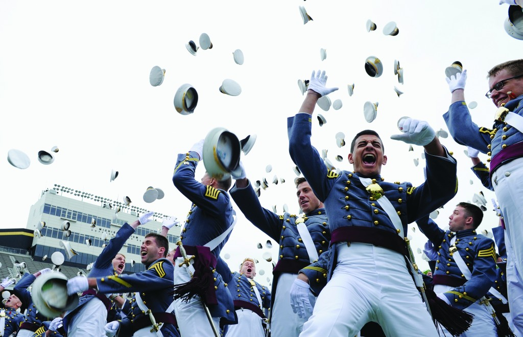 The 2014 graduating class of the U.S. Military Academy at West Point on Wednesday toss their hats in celebration. (AP Photo/Susan Walsh)