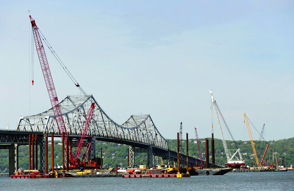 Construction crews on Tuesday work on a replacement for the 58-year-old Tappan Zee Bridge spanning the Hudson River. (AP Photo/Julie Jacobson)