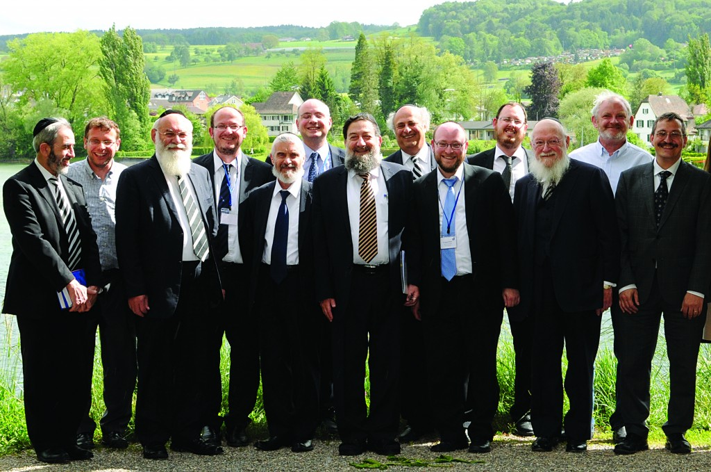 "The 3rd International Conference on Jewish Medical Ethics entitled ""Truth and Economics in Medicine"" was held in the picturesque town of Stein am Rhein, Switzerland, with over 180 participants  from 11 countries from May 8th–11th, 2014. During the conference, series of lectures, panel discussion and courses covered some of the most important and fascinating topics in Medical Ethics, such as Allocating Scarce Resources, Personalized Medicine, Scientific Independence versus Economic Interests, to explore ""Truth and Economics in Medicine"" from an Ethical and Jewish perspective.  The conference was organized by the three local physicians R. Guggenheim, Y. Nordmann and R. Patcas in close collaboration with the University of Zurich.  Pictured are some of the speakers and organizers of the 3rd International Conference on Jewish Medical Ethics in Switzerland. From left to right:  Rabbi D. Oppenheimer (Buenos Aires), Prof. A. Nordmann (Basel), Rabbi Prof. A. Steinberg (Jerusalem), Dr. Y. Nordmann (Basel), Rabbi Dr. A. Tatz (London), Dr. R. Guggenheim (Zurich), Rabbi Dr. M. Halperin (Jerusalem), Prof. Dr. D. Pelcovits (NY), Dr. R. Patcas (Zurich), L. Fridmann (Basel), Rabbi Prof. J. D. Bleich (NY), Dr. B. Gesundheit (Jerusalem), Prof. Dr. M. Hengartner (Zurich) (JMEC 2014 via Kuvien Images)"