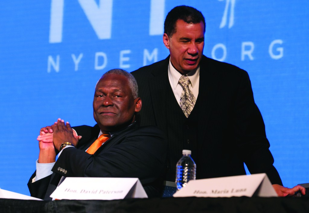 David Paterson (R) on Wednesday is congratulated by Keith Wright. (AP Photo/Richard Drew)