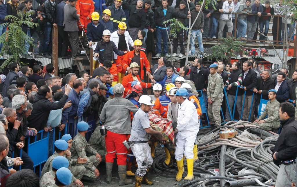 Rescuers carry a miner who sustained injuries after the mine explosion.