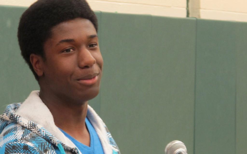 Kwasi Enin speaks Wednesday at his Mastic Beach, N.Y., high school. (AP Photo/Frank Eltman)