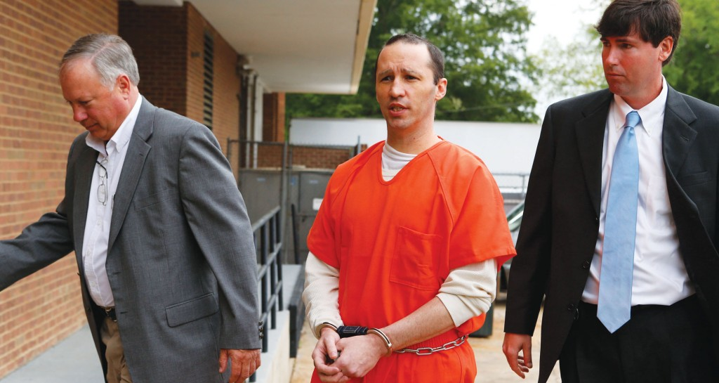 In this May 13 photo, James Everett Dutschke (C) is led by U.S. Marshalls into the Federal Building in Aberdeen, Miss. Dutschke, who pleaded guilty to sending letters dusted with the poison ricin to President Obama and other officials.(AP Photo/Northeast Mississippi Daily Journal, Thomas Wells)