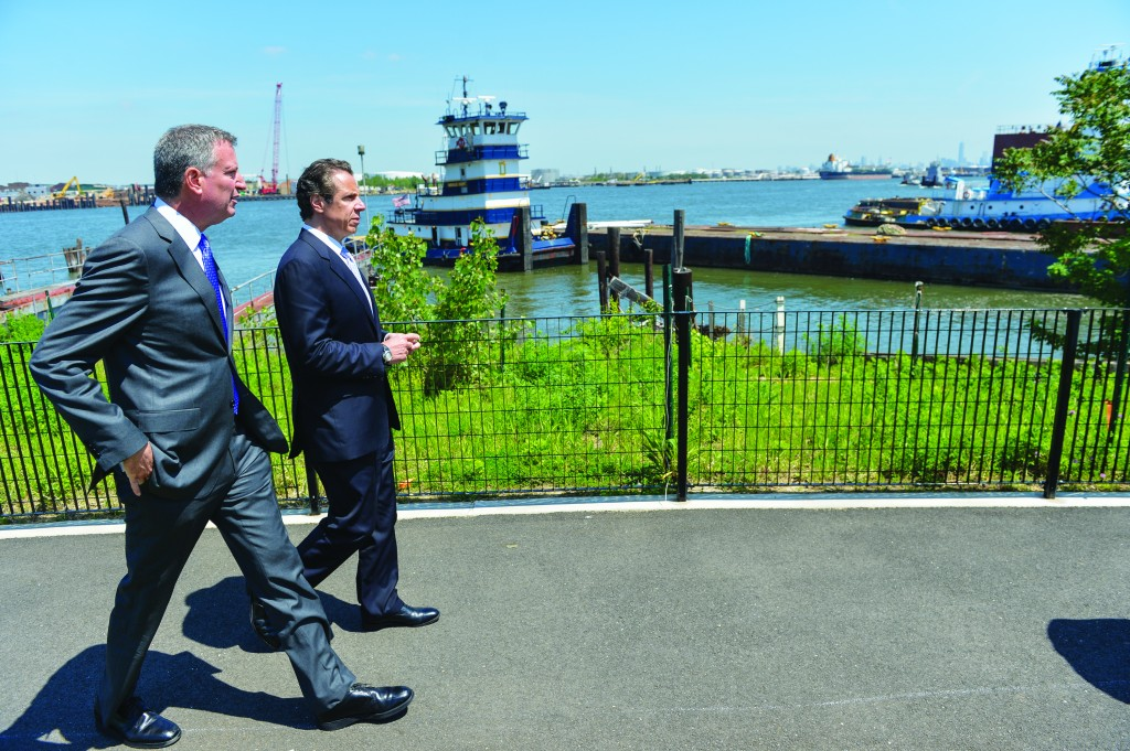 Gov. Andrew Cuomo and Mayor Bill de Blasio on Thursday walk to a Sandy relief bill signing ceremony in Staten Island. (Office of the Governor)