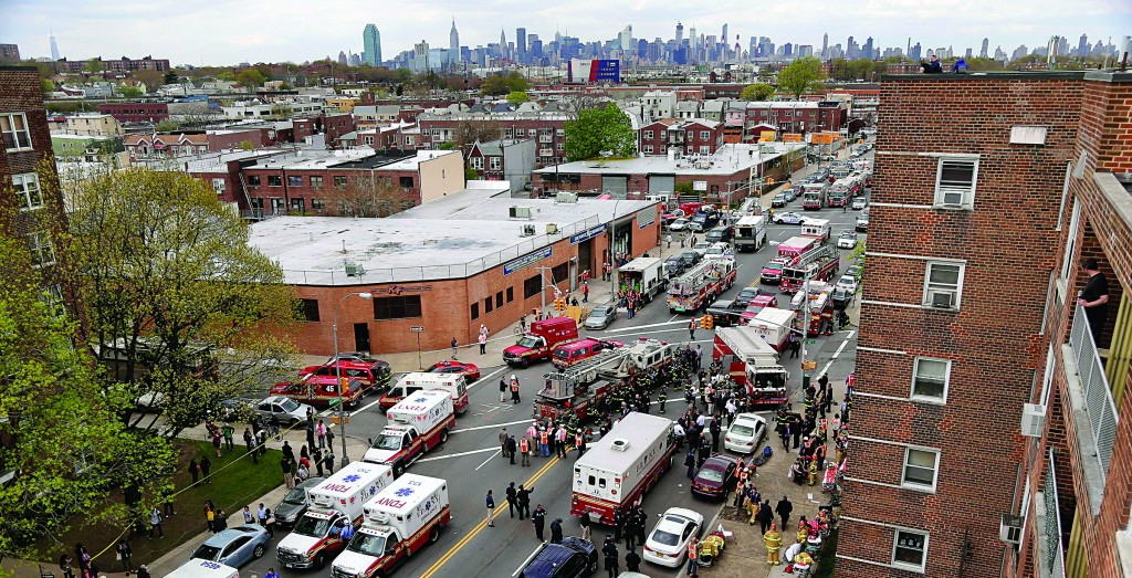Emergency crews on Friday converge at 60th Street and Broadway to evacuate passengers from the subway F train derailment in Queens. (AP Photos)