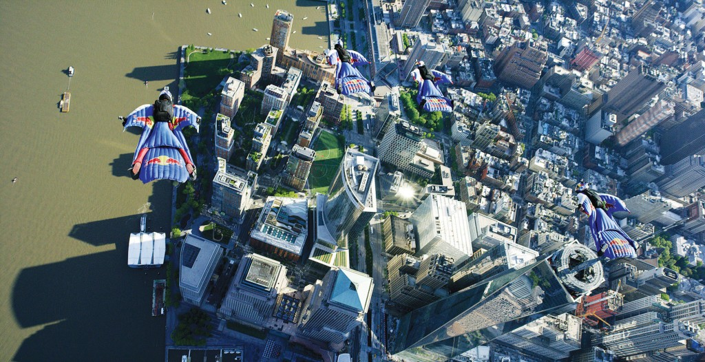 Dressed for Flying: Four flyers in wingsuits fly past 1 World Trade Center, lower right, on Sunday, the first time a wingsuit flight was permitted to take place over New York. (AP Photo/Red Bull, Andy Farrington)
