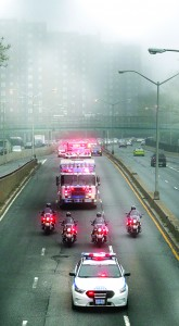 Emergency vehicles on Saturday lead a procession along the FDR Drive with remains of victims of the 9/11 attacks. (AP Photo)