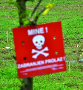 Bosnian soldiers searched for mines in fields near the banks of the river Bosnia, which flooded near the town of Visoko. The flooding has unearthed landmines left over from Bosnia's 1992-1995 war and has washed away the warning signs. (AP Photo/Sulejman Omerbasic)