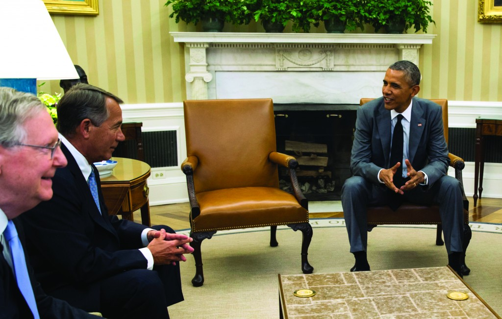 U.S. President Barack Obama meets with Senate Minority Leader Mitch McConnell (R-Ky.) (L) and Speaker of the House John Boehner (R-Ohio) (C) to discuss the sitaution in Iraq in the Oval Office of the White House in Washington, Wednesday.  (REUTERS/Kevin Lamarque)