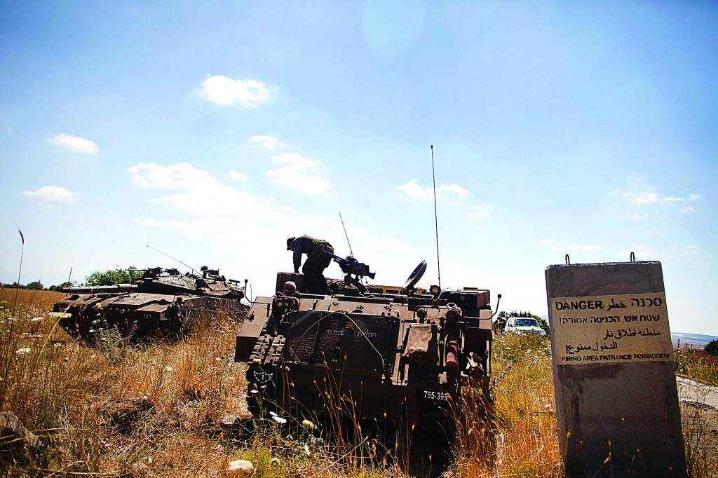 Israeli soldiers on patrol in the Golan Heights after a 13-year-old Israeli boy was killed Sunday morning. (Flash90)