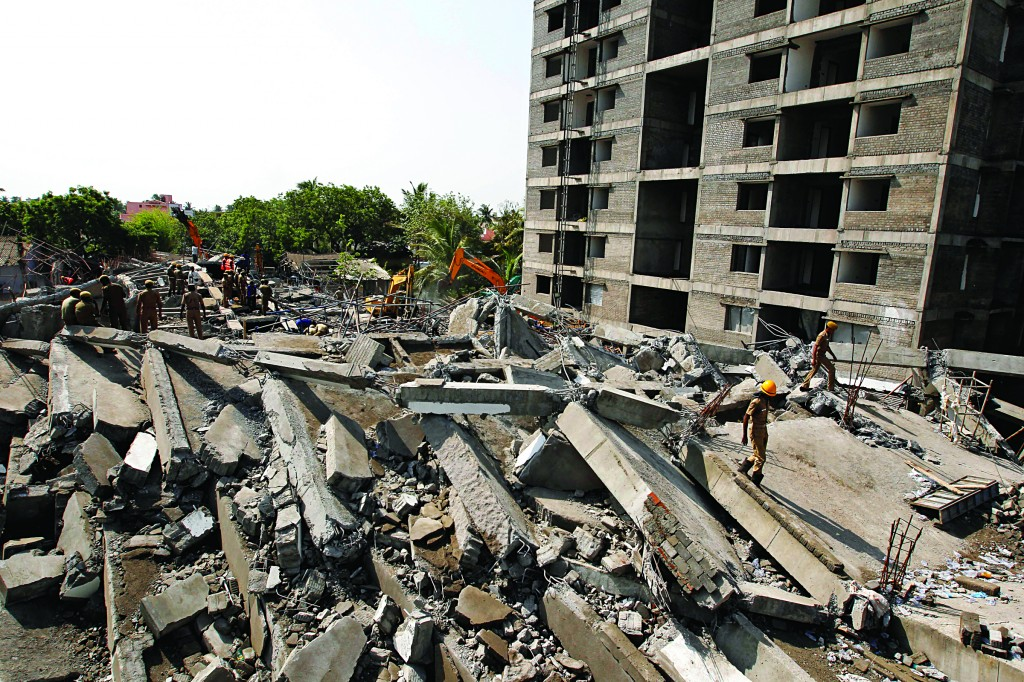 Rescuers search for workers believed buried in the rubble of a building that collapsed on the outskirts of Chennai, India, Sunday (AP Photo/Arun Sankar K)