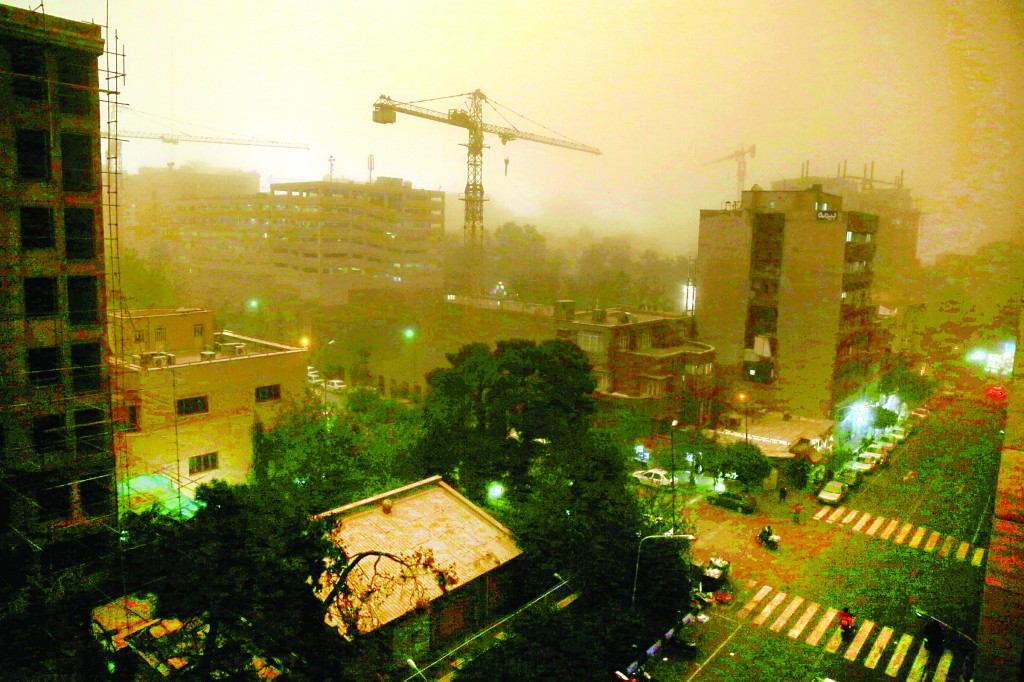 A view of Tehran, Iran, Monday, during a flash dust storm that hit the Iranian capital. (AP Photo/Ebrahim Noroozi)