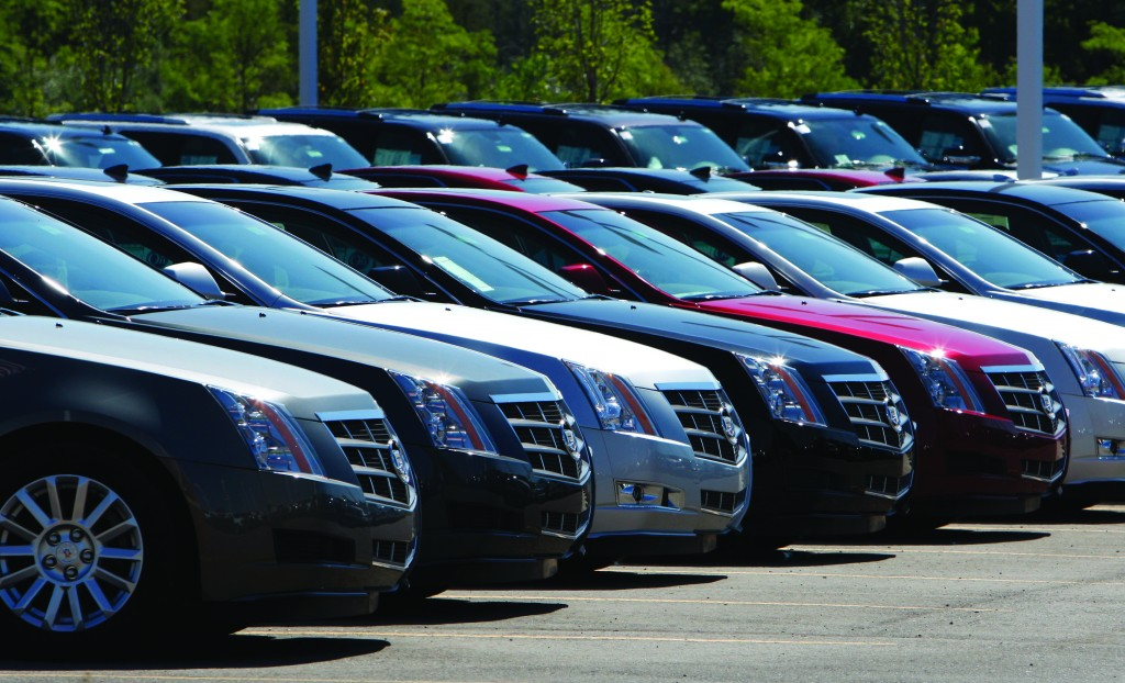 Cadillac CTS vehicles being displayed outside the LaFountaine Cadillac in Highland Township, Mich. (AP Photo/Carlos Osorio, File)