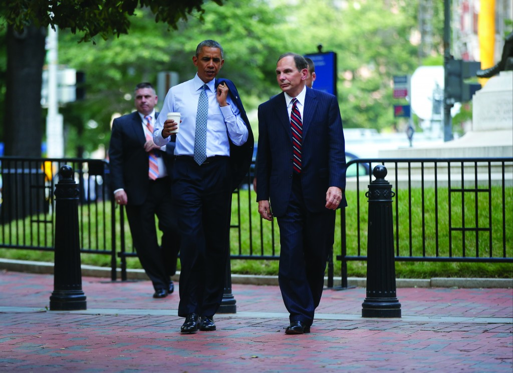 President Obama walks Monday with Procter & Gamble CEO Robert McDonald, Obama's nominee as the next VA secretary, from the Department of Veterans Affairs across Lafayette Park back to the White House. (AP Photo/Charles Dharapak)