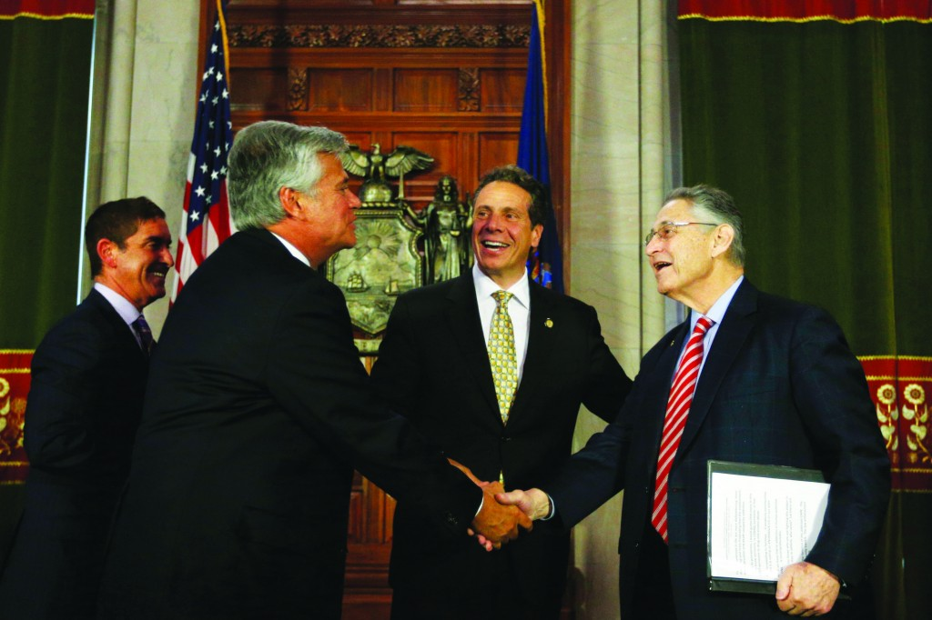L-R: Senate co-leader Jeff Klein of the IDC, Senate Republican leader Dean Skelos, Gov. Andrew Cuomo and Assembly Speaker Sheldon Silver on Wednesday leave a news conference at the Capitol. (AP Photo/Mike Groll)