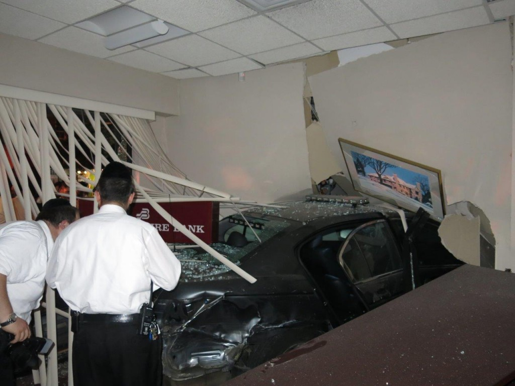 A car hit the Berkshire Bank on 13th Ave., then slammed into the Montgomery Stationery store next door early Friday. (JDN)