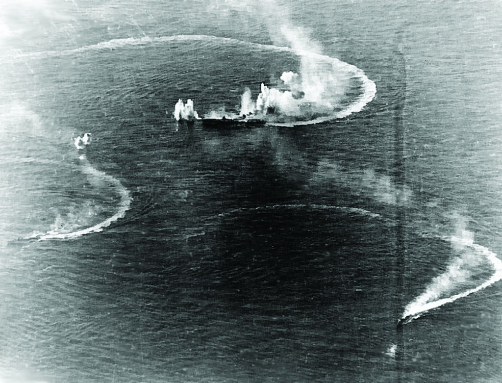 Japanese aircraft carrier Zuikaku (center) and two destroyers maneuvering, while under attack by U.S. Navy carrier aircraft, during the sunset attack on June 20, 1944. Zuikaku was hit by several bombs during these attacks, but survived.  (Source US Navy )