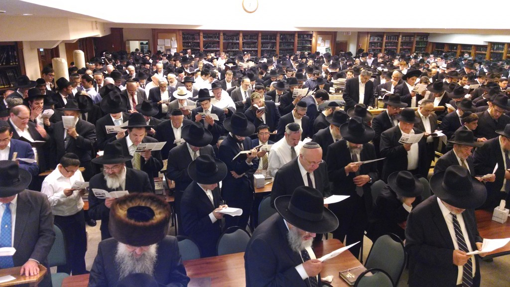 Hundreds of members of the Queens community joined together at Yeshiva Ohr Hachaim on Motzoei Shabbos for a night of achdus and tefillah arranged by the CHAZAQ organization on behalf of the three teenagers kidnapped by terrorists in Israel. As the search for three kidnapped Israeli teenagers entered its second week, hundreds of additional IDF troops  were dispatched to Yehudah and Shomron where raids, skirmishes and arrests continued over the weekend, but no breakthrough in locating the missing boys was reported. (Reuven Kay)