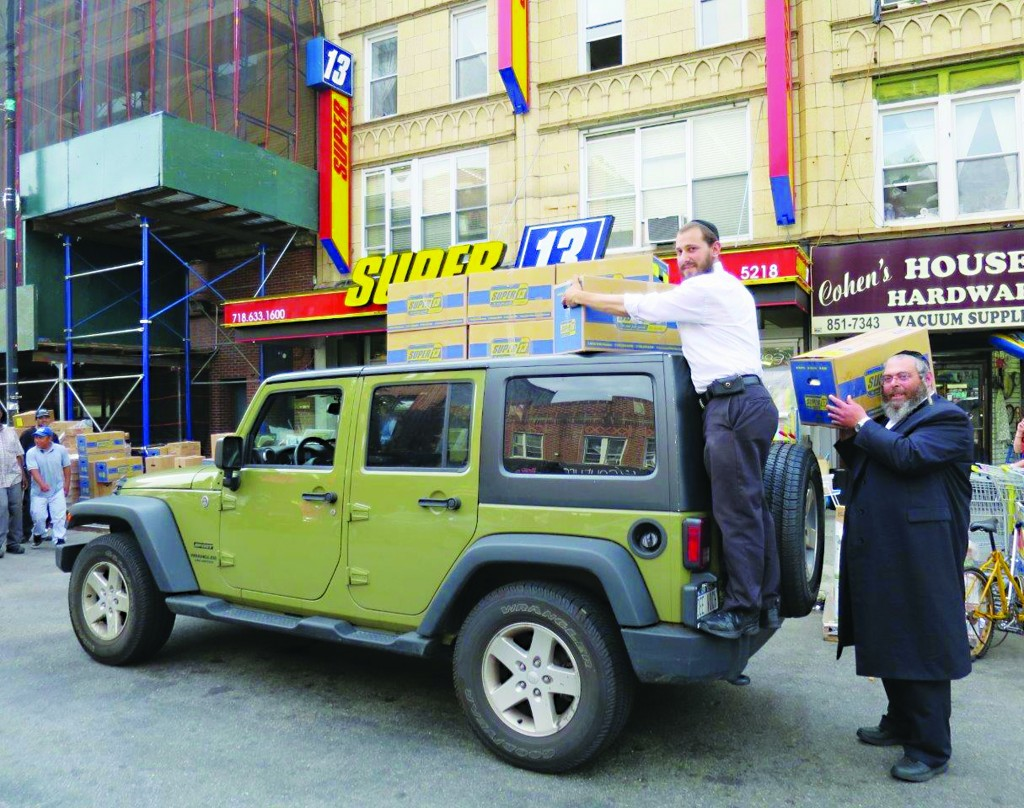 Thursday marked the first day of the annual summer season, as thousands of Jewish familes, including from Boro Park, head up to the Catskills. (JDN)