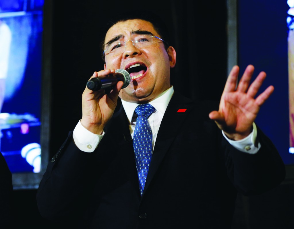 Chinese tycoon Chen Guangbiao on Wednesday sings for his guests. (AP Photo/Seth Wenig)
