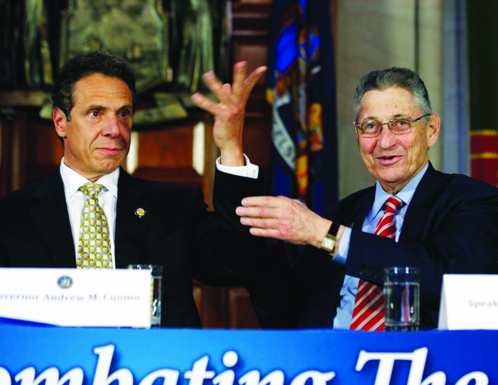 "Assembly Speaker Sheldon Silver on Wednesday raises Gov. Andrew Cuomo's arm after Cuomo said he is ""pliable"" during a news conference. (AP Photo/Mike Groll)"