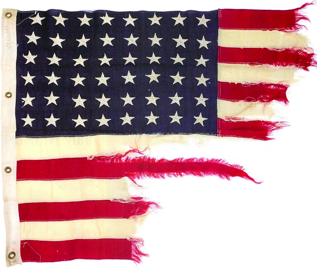A tattered 48-star American flag that flew aboard a U.S. Navy ship on D-Day. (AP Photo/Bonhams)